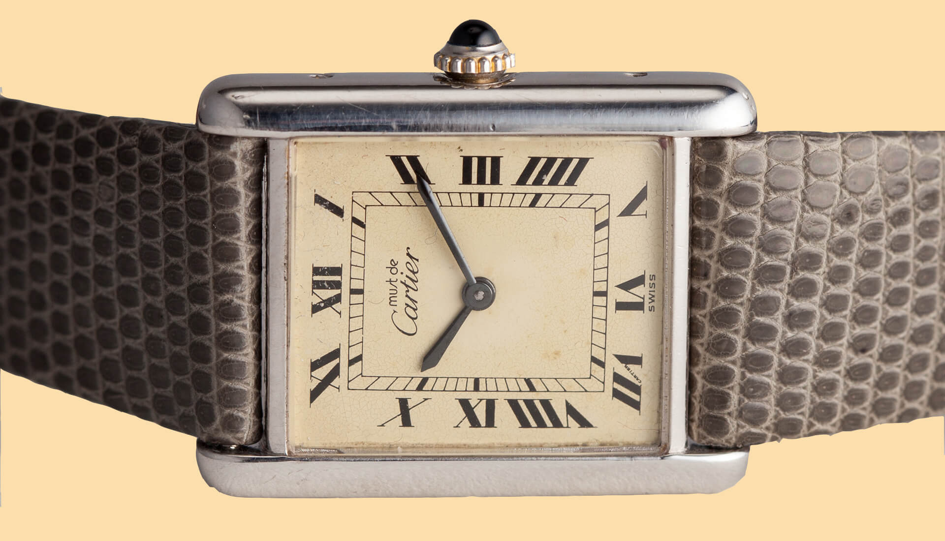 In The Metal: Rolex Oyster Perpetual, Must de Cartier Tank, & a Vintage Alarm
